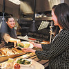 John P. Cleary |  The Herald Bulletin<br /> Sarah Loser serves Carrie Scott, a dietitian for St. Vincent Anderson Regional Hospital, a grilled chicken breast to go with other healthy food options that Scott has on her tray from the hospital's cafeteria.