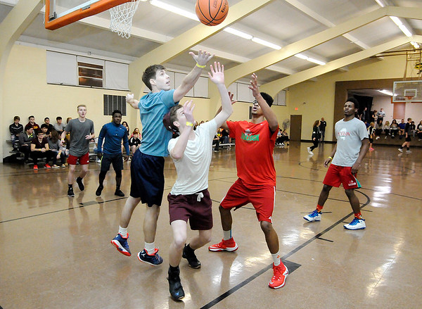 Don Knight | The Herald Bulletin<br /> Students grab for a rebound during a three-on-three basketball tournament at the Youth Leadership Academy's annual Dance Marathon Saturday. The YLA leads area High School juniors through a year-long program of leadership courses, management training and volunteer work.