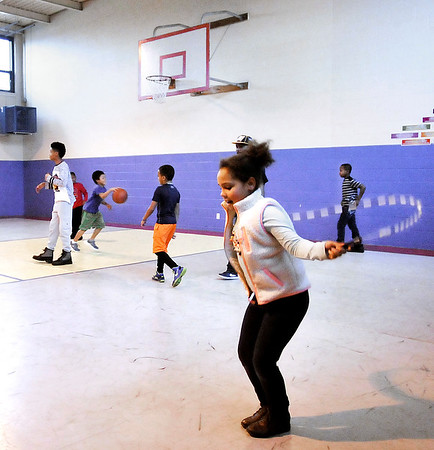 John P. Cleary |  The Herald Bulletin<br /> Raquell Jackson, 9, enjoys jumping rope as other kids are playing basketball this past Tuesday afternoon after school at the Anderson Trustee Girls & Boys Club.
