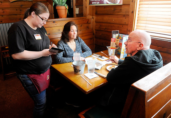 Don Knight | The Herald Bulletin<br /> Amanda Malone takes the order of Richard and Kim Irwin at Texas Roadhouse. The restaurant was voted as best ribs, steak and dine-in restaurant by The Herald Bulletin readers.