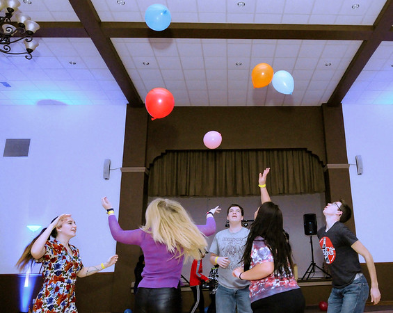 Don Knight   The Herald Bulletin<br /> Students hit balloons up in the air as the Youth Leadership Academy held their annual Dance Marathon in Chesterfield on Saturday. Proceeds from the event benefit area non-profits.