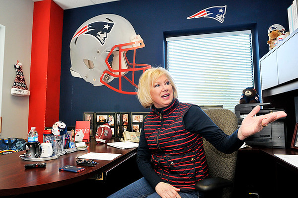 John P. Cleary    The Herald Bulletin<br /> JoAnna Collette, executive director of JobSource, shows off her office that is covered with New England Patriots memorabilia. Collette grew up in New Jersey and has been a long-time Patriots fan, even in central Indiana.