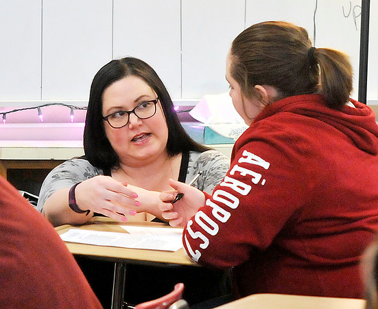 John P. Cleary |  The Herald Bulletin<br /> Highland Middle School teacher Jennifer Morgan works with a seventh-grade student in her English/Reading class where she co-teaches with Melissa Treadway.