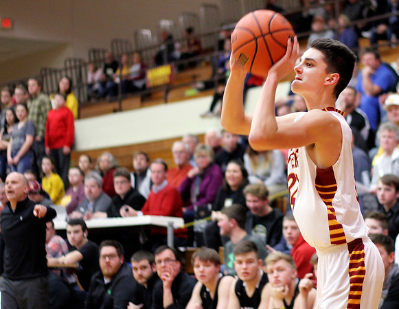 Chris Martin   For The Herald Bulletin<br /> Alexandria's Isaac Granger takes a baseline three pointer Friday night in a home game against Madison-Grant.