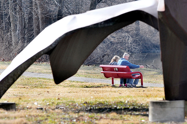 John P. Cleary |  The Herald Bulletin<br /> Framed by part of the Life Sculpture at Shadyside Park these folks enjoy the warm temperature of February to enjoy the trail and the lake on Presidents' Day.
