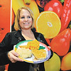 John P. Cleary |  The Herald Bulletin<br /> Jenny Martin, nutrition coordinator for Community Hospital Anderson, shows  a balanced meal.