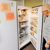Don Knight   The Herald Bulletin<br /> Jack Mendenhall looks into a freezer at the Lapel Food Pantry on Wednesday. Daybreak Community Church held a dinner for Lapel Food Pantry volunteers.