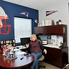 John P. Cleary |  The Herald Bulletin<br /> JoAnna Collette, executive director of JobSource, shows off her office that is covered with New England Patriots memorabilia. Collette grew up in New Jersey and has been a long-time Patriots fan, even in central Indiana.