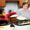 Don Knight | The Herald Bulletin<br /> Isaiah Young, 8, scoops up a serving of noodles for his mom Jenni Young as<br /> Daybreak Community Church held a dinner for volunteers of the Lapel Food Pantry on Wednesday.