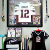 John P. Cleary |  The Herald Bulletin<br /> JoAnna Collette, executive director of JobSource, is a big Patriots fan with her office full of Patriot memorabilia including a signed Tom Brady jersey.