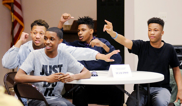 Don Knight   The Herald Bulletin<br /> From left, Machyie Carter, Austin Morgan, Jaytez Morgan and U'John Gallins are anxious to answer a question as they take part in a Black History Quiz Bowl at Sherman Street Church of God on Wednesday.