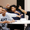 Don Knight | The Herald Bulletin<br /> From left, Machyie Carter, Austin Morgan, Jaytez Morgan and U'John Gallins are anxious to answer a question as they take part in a Black History Quiz Bowl at Sherman Street Church of God on Wednesday.