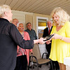 Don Knight | The Herald Bulletin<br /> Sister 2 Sister Executive Director gives a plaque to Jeanne Mudd at Sister 2 Sister's location on Arrow Avenue on Friday. The home will be called the Mudd house in honor of Mudd's contributions to the organization.