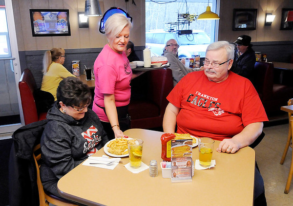 Don Knight | The Herald Bulletin<br /> Lisa Fortune serves Dan and Judy Frazier their dinner at The Curve. Fortune was chosen by readers of The Herald Bulletin as the best waitress.