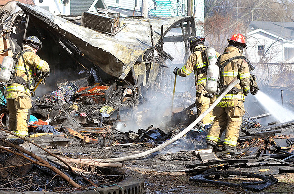 John P. Cleary    The Herald Bulletin<br /> Anderson firefighters put out hot spots after battling a trailer fire in the 3000 block of East Lynn Street Tuesday afternoon.
