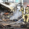 John P. Cleary |  The Herald Bulletin<br /> Anderson firefighters put out hot spots after battling a trailer fire in the 3000 block of East Lynn Street Tuesday afternoon.