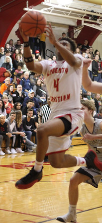 Chris Martin for The Herald Bulletin.  Liberty Christian's Ronny Williams goes for a layup against Daleville at home Saturday night.