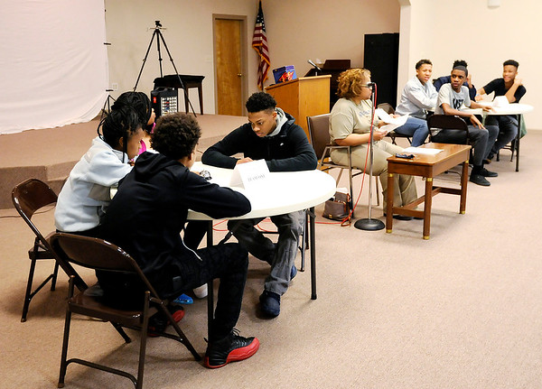Don Knight | The Herald Bulletin<br /> Two teams of high school students participate in a Black History Quiz Bowl at Sherman Street Church of God on Wednesday.