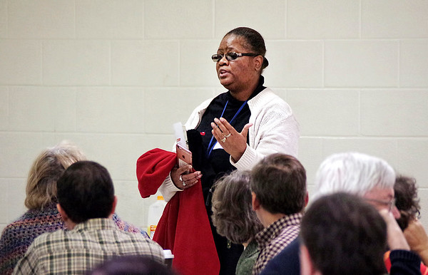 Mark Maynard   For The Herald Bulletin<br /> Monica James of Muncie tells the crowd about the concerns she addressed with U.S. Representative Susan Brooks on Saturday.