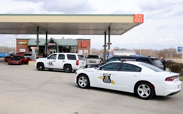 Don Knight | The Herald Bulletin Police detained five people following a police chase that ended at the Ricker's at 53rd and Dr. Martin Luther King Jr. Boulevard on Friday.