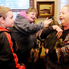 Don Knight | The Herald Bulletin<br /> Danene Eckelbarger pets Jesse as Angie Chase holds him and Jeffery Eckelbarger looks on. The Chases stepped forward to care for Jeffery's cat Jesse as his parents battle severe health problems.