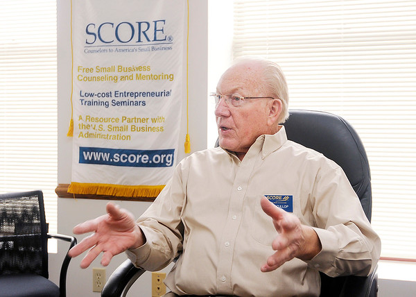 Don Knight | The Herald Bulletin<br /> Tom Cullop talks about the SCORE business mentoring program at SCORE's office on Friday.