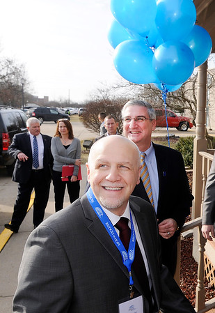 Don Knight | The Herald Bulletin<br /> Bridges of Hope CEO and Gov. Eric Holcomb look to the sky as a drone records the scene during the grand opening of Bridges of Hope on Saturday.