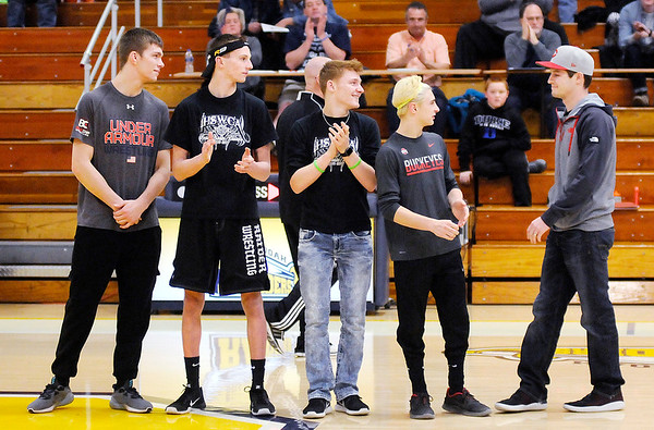 Don Knight   The Herald Bulletin<br /> Shenandoah recognized their four wrestlers going to state and their coach during halftime of the Raiders game against the Yorktown Tigers on Wednesday. From left are Josh Gee, Ryan Surguy, Dallas Pugsley, A.J. Black and coach Gary Black.