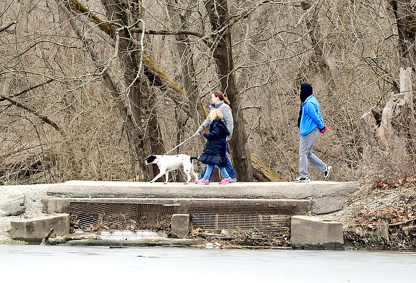 John P. Cleary    The Herald Bulletin<br /> With temperatures reaching into the 50's, it was a good time to take a family walk with the dog around the trials at Shadyside Park Monday afternoon. Temperatures are forecast to be even warmer Tuesday but with chance of thunderstorms before turning colder and a chance of snow.