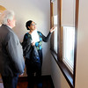 Don Knight | The Herald Bulletin<br /> Lelia Kelley with Anderson Community Development gives Mayor Thomas Broderick Jr. a tour of Abbott Apartments during their grand opening on Thursday.