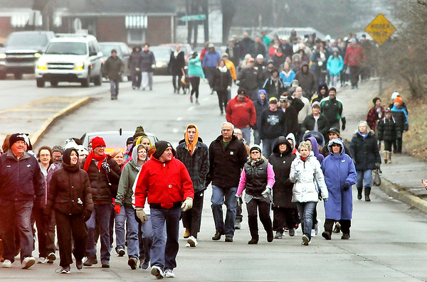 """John P. Cleary   The Herald Bulletin<br /> Participants in The Christian Center's annual """"Walk a Mile in My Shoes"""" fund raiser work their way along University Blvd. toward the Truman Bridge Saturday morning as they walk to The Christian Center from AU."""