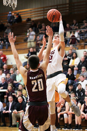 Chris Martin | For The Herald Bulletin<br /> Alexandria's Avery Paddock drives to the rim Friday night at home against Wes-Del.