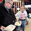 "John P. Cleary | The Herald Bulletin<br /> Larry ""The Can Man"" VanNess, right, greets Rev. Paul Featherstone as he gets some birthday cake Saturday afternoon during ""The Can Man's"" 71st  birthday party held at McDonald's at 111 W. 14th Street in Anderson."