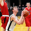 Don Knight | The Herald Bulletin<br /> Daleville's Hayden Huff draws a foul from Blackford's Mark White while shooting on Tuesday.