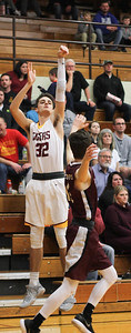 Chris Martin for The Herald Bulletin Alexandria's Avery Paddock shoots a long range jump shot Friday night at home against Wes-Del.
