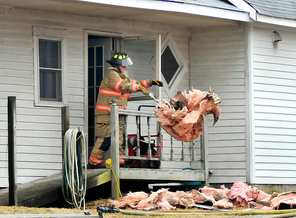 John P. Cleary | The Herald Bulletin<br /> Firefighters from several agencies made a quick stop of a structure fire to contain the damage to the kitchen and ceiling area of a residence at 7060 West 1100 South outside of Ingalls Wednesday afternoon.