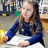 John P. Cleary | The Herald Bulletin<br /> Maggie Henning, of Edgewood, works on her numbers in Zach Fuqua's kindergarten class at Lapel Elementary School Monday. Frankton-Lapel Community Schools experienced the greatest influx of transfer students from surrounding communities.