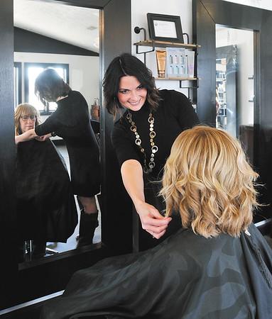 John P. Cleary | The Herald Bulletin<br /> Serendipity Hair Salon, in Pendleton, won Best Of hair salon. Here Rachele Martin puts the finishing touches on customer Beverly Clark.