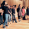 "Youth center participant Saniya Cox leads the choir in singing ""Lift Ev'ry Voice and Sing,"" known as the black national anthem."