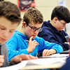 John P. Cleary | The Herald Bulletin<br /> Alexandria-Monroe sixth grader Lukas Sullivan thinks his problem through as he takes a pre-calculus test in Krystal Hill's Alexandria-Monroe Jr.-Sr. math class.