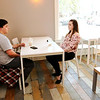 Don Knight | The Herald Bulletin<br /> From left, Will McCowan and Sydney Bundy sit and enjoy their drinks at Falls Perk coffee shop in Pendleton.