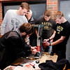 Don Knight | The Herald Bulletin<br /> Lapel's robotics club prepares their robot for it's next bout during a VEX Robotics competition hosted by Anderson University's Science and Engineering. From left are Griffin Knepp, Joseph Conrad, Matthew Burnell and Joey Stern.