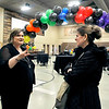 John P. Cleary | The Herald Bulletin<br /> Amy Buck Boyer, left, founder and CEO of Changing Lives BAS, welcomes visitors Tuesday during an open house and ribbon cutting for their new facilities at 550 W. 37th Street. Changing Lives has partnered with Journey Church of Christ for space in the former Meadowbrook School building that the church has now.