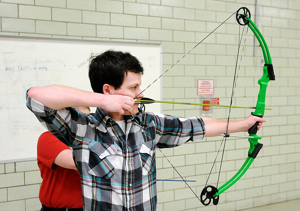 Don Knight | The Herald Bulletin<br /> Brenden Carrell, 18, takes aim during archery practice at APA on Tuesday. Carrell qualified for state competition on March 10th.