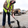 John P. Cleary | The Herald Bulletin<br /> Anderson City Street Department employee Remington Emery fills potholes Monday along Ames Street in North Anderson.