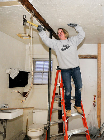John P. Cleary | The Herald Bulletin<br /> Pam Stiers, founder of the Homeless Advocacy Shelter of Anderson and Madison County, works on remodeling of the building they are buying for a homeless shelter at 512 Jackson Street in Anderson.