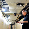 John P. Cleary | The Herald Bulletin<br /> Dan Dykes, Madison County administrator, explains what has been done on the third floor of the Madison County Government Center Friday as the flooring and ceilings have been removed, and walls encapsulated in plastic in preparation of the start of removing the asbestos.
