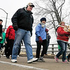 "John P. Cleary | The Herald Bulletin<br /> Participants in The Christian Center's annual ""Walk a Mile in My Shoes"" fund raiser wak across the Truman Bridge Saturday morning as they walk to The Christian Center from AU."