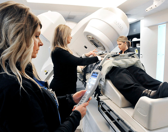 John P. Cleary | The Herald Bulletin<br /> Heather Clawson, RTT, Dr. Jennifer Zook, and Melissa Andrews, RTT, prep a patient for treatment with the new TruBeam radiotherapy unit at Community Hospital.