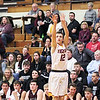 Chris Martin | For The Herald Bulletin<br /> Alexandria's Sam Hensley shoots a three pointer Friday night at home against Wes-Del.